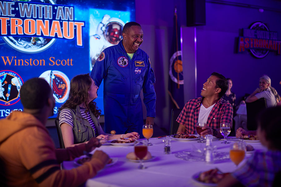Astronaut Winston Scott speaks with guests during Dine With An Astronaut.