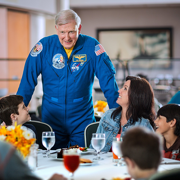 Astronaut Jon McBride with lunch guests