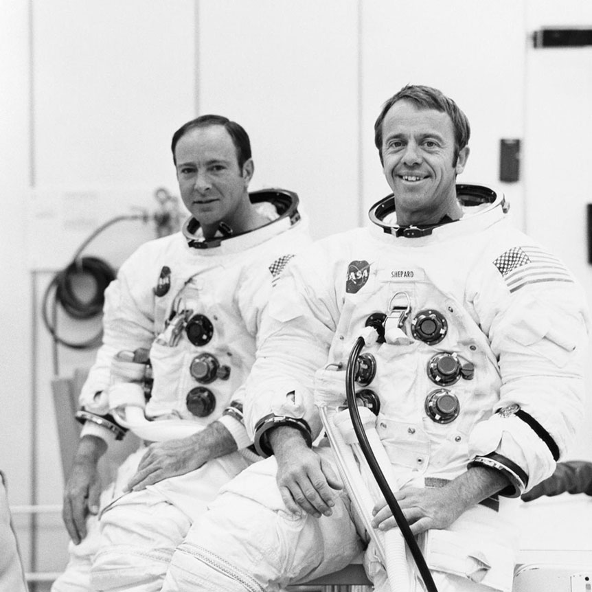 Astronauts Edgar Mitchell (L) and Alan Shepard (R) in their Apollo 14 spacesuits in 1970