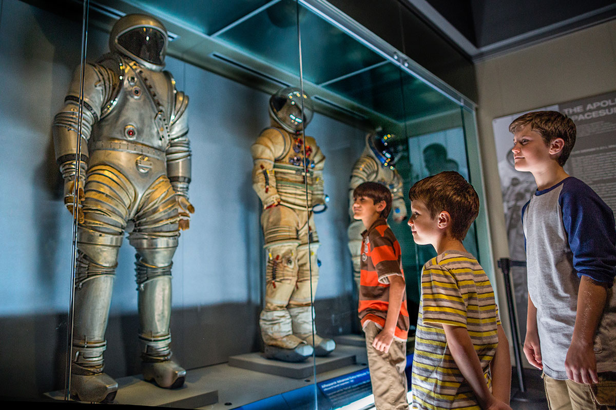 Children stare in awe at the Space Suit designs in the Treasures Gallery