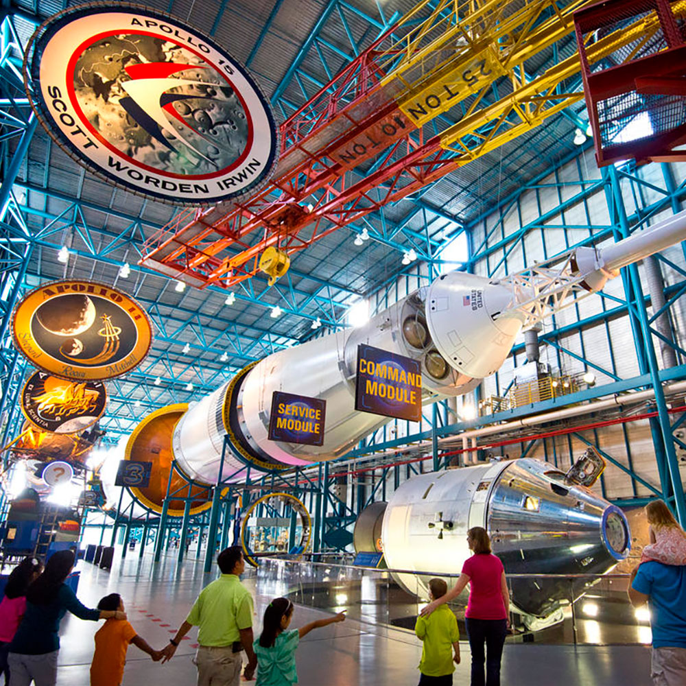 Guests explore the Apollo/Saturn V Center which includes the Saturn V moon rocket at the Kennedy Space Center Visitor Complex.