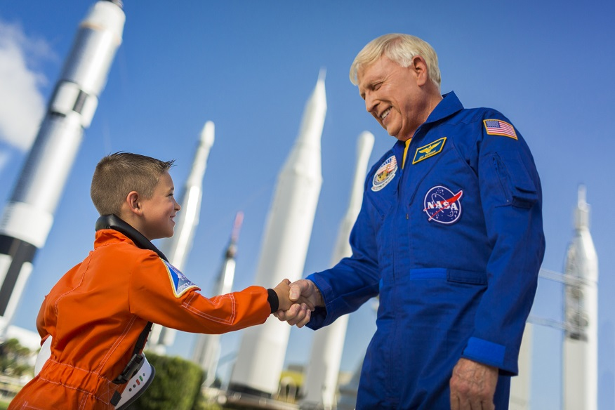 Astronaut Jon McBride shaking hands with a child.