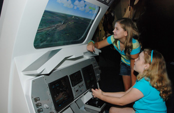 Children Operating Landing Simulator
