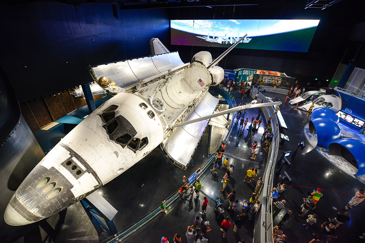 View of the space shuttle Atlantis exhibit from above, with the shuttles cargo bay doors open