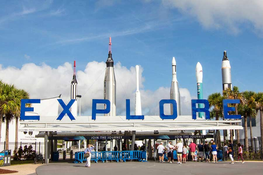 Front gates at Kennedy Space Center Visitor Complex with the Rocket Garden in the background
