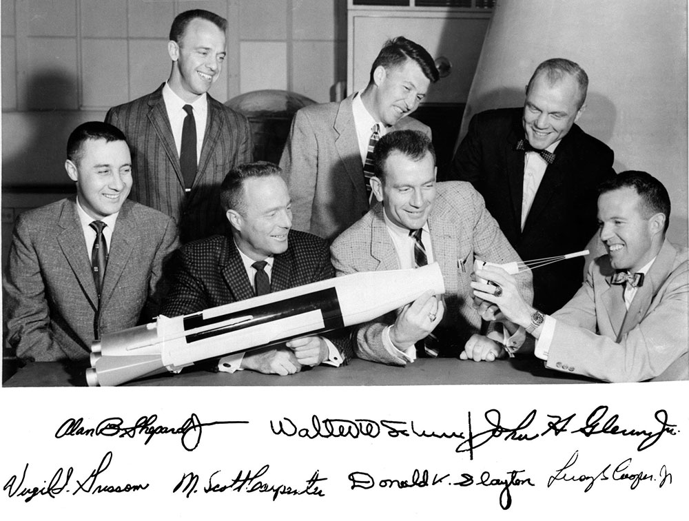 The original Mercury 7 astronauts with at Atlas model in 1959.