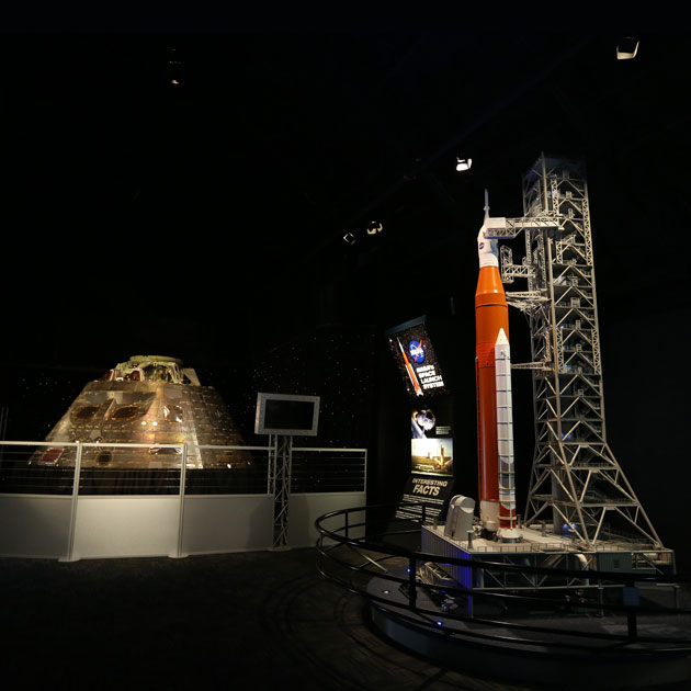 The Orion Crew Vehicle from the EFT-1 Mission and the scale model of the NASA Space Launch System are on display in NASA Now.