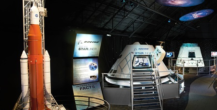 The NASA Now and Next exhibit includes a scale model of NASA Space Launch System, Boeing CST-100 Starliner Crew Vehicle Pressure Vessel and SpaceX Dragon Cargo Vehicle, at Kennedy Space Center Visitor Complex.