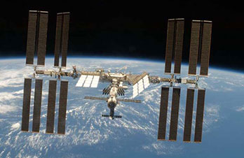 View of the International Space Station above Earth.