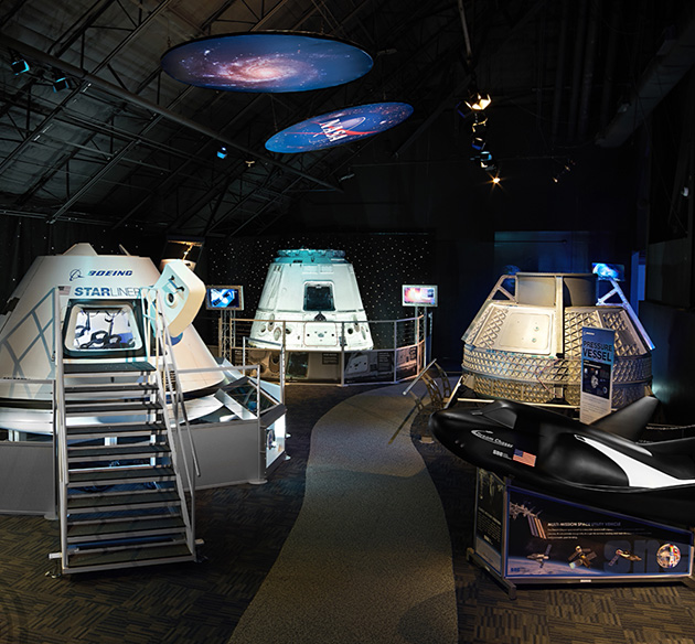 NASA Now exhibit at Kennedy Space Center Visitor Complex including SpaceX Dragon Cargo Vehicle from COTS-2 Mission, Orion Crew Vehicle from EFT-1 Mission and more.
