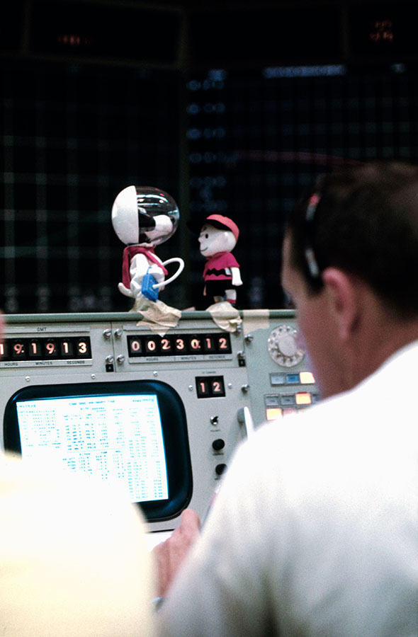 Snoopy and Charlie Brown sit atop of a console in the Mission Control Center.