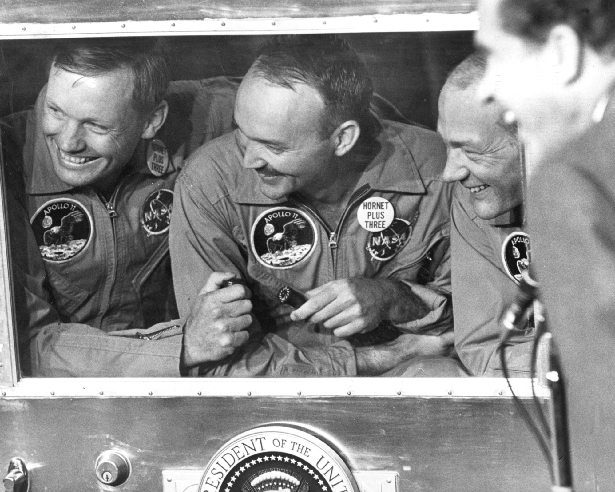 Apollo 11 laughing through quarantine window