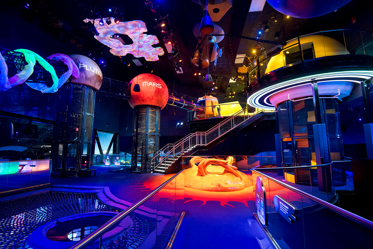 The second floor of Planet Play at Kennedy Space Center Visitor Complex includes the planets Mars, Merury and Pluto, along with the Sun.
