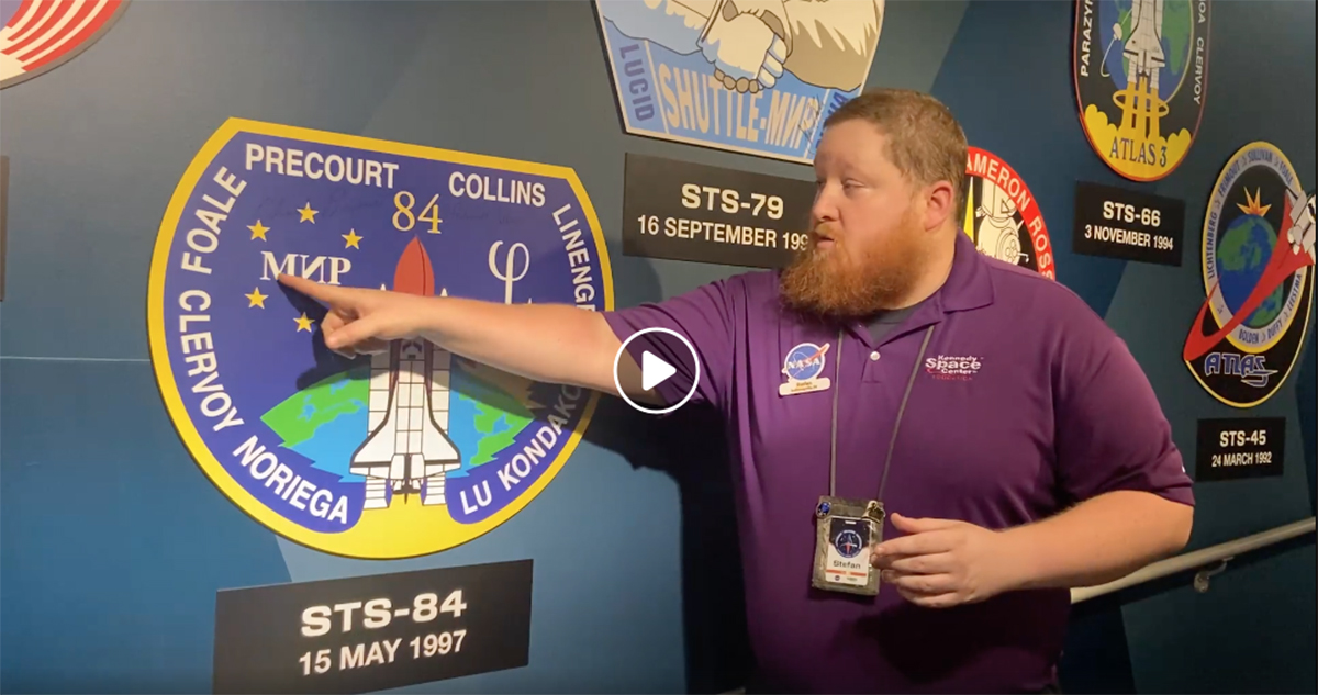 Kennedy Space Center Visitor Complex educator speaks about mission patches in one of the educational videos.