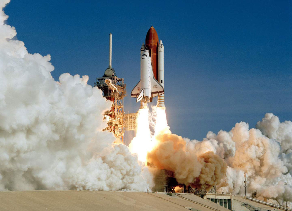 Space shuttle Discovery launches from Launch Pad 39A at Kennedy Space Center for its maiden voyage on August 30, 1984.