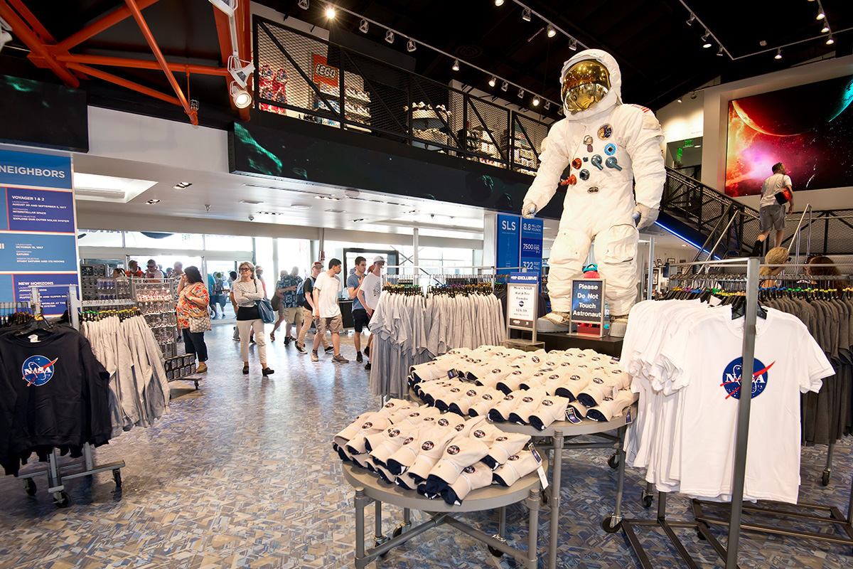 Interior of the Space Shop, with NASA clothing and gifts on display.