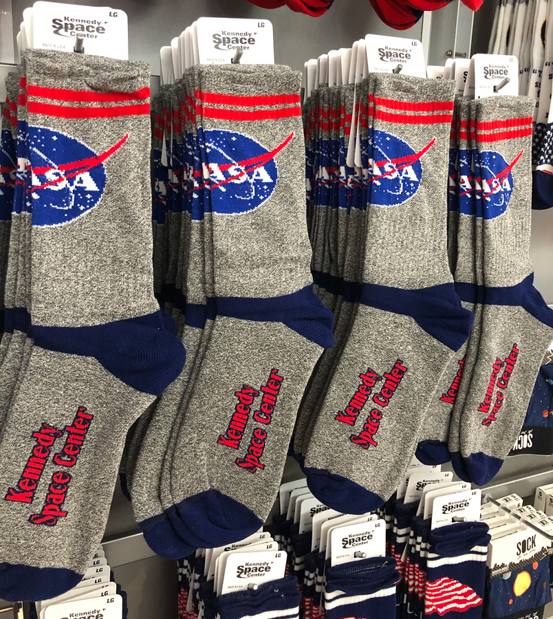 Socks with the NASA logo and Kennedy Space Center on it.