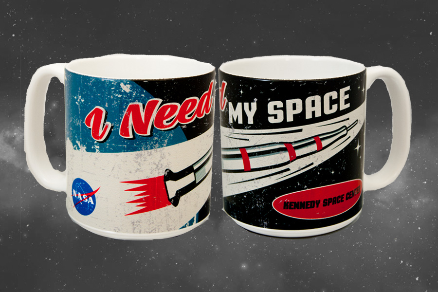 Ceramic mug with a retro style Saturn V rocket and the quote 'I need my space' printed on it.