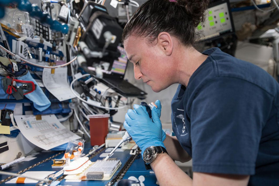 Expedition 57 Flight Engineer Serena Auñón-Chancellor is pictured mixing protein crystal samples to help scientists understand how they work.