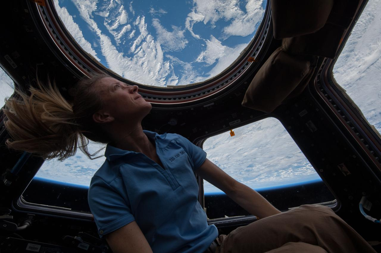 Astronaut Karen Nyberg, Expedition 37 flight engineer, is photographed in front of the windows in the Cupola module .