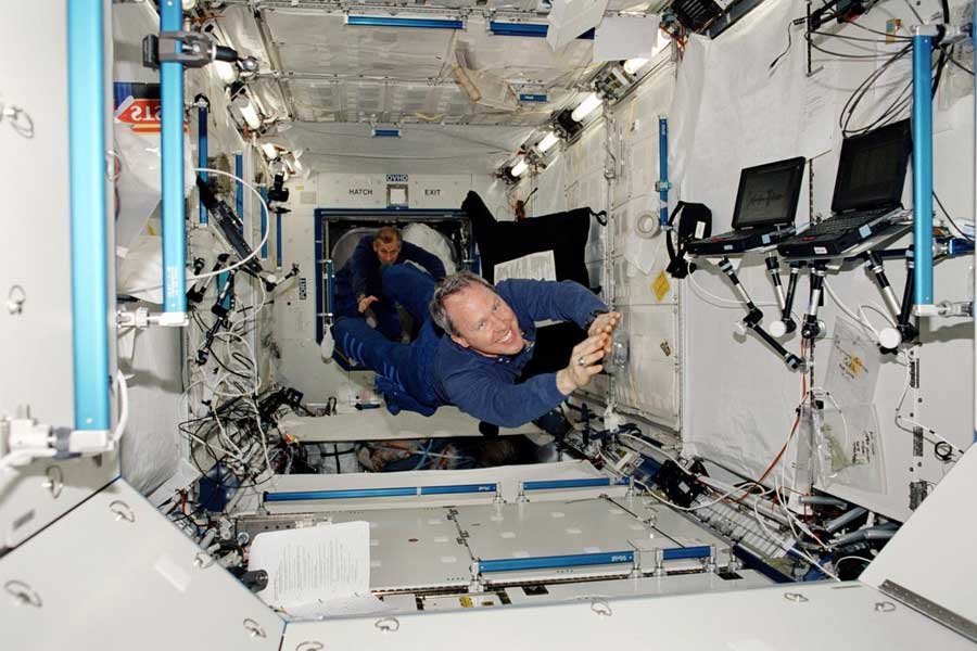 This STS-98 mission photograph shows astronauts Thomas D. Jones (foreground) and Kerneth D. Cockrell floating inside the newly installed Laboratory aboard the International Space Station (ISS).