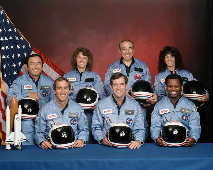 Challenger STS-51L Crew (left to right, front row) astronauts Michael J. Smith, Francis R. (Dick) Scobee and Ronald E. McNair; Ellison S. Onizuka, Sharon Christa McAuliffe, Gregory Jarvis and Judith A. Resnik. McAuliffe and Jarvis are payload specialists, representing the Teacher in Space Project and Hughes Company, respectively.