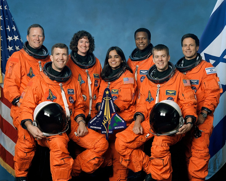 Columbia STS-107 crew (front, from left): astronauts Rick D. Husband, mission commander; Kalpana Chawla, mission specialist; and William C. McCool, pilot. Standing, from left, are: David M. Brown, Laurel B. Clark, and Michael P. Anderson, all mission specialists; and Ilan Ramon, payload specialist, representing the Israeli Space Agency.