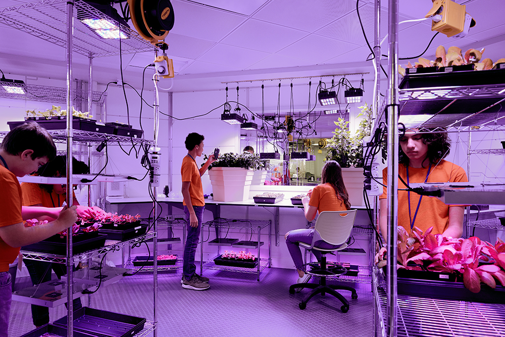 Students working in the Mar Base 1 Botany Lab in the ATX Center at Kennedy Space Center Visitor Complex.