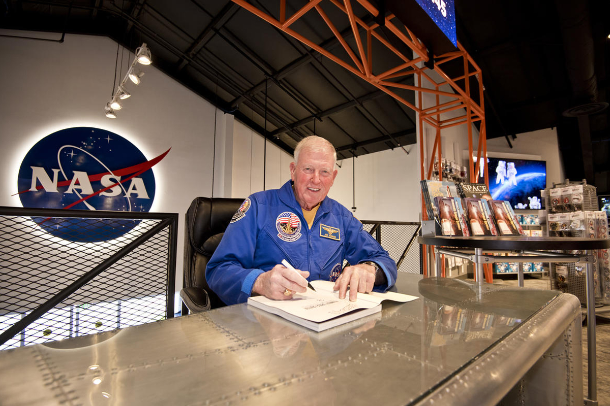 Astronaut Jon McBride signing autographs in The Space Shop