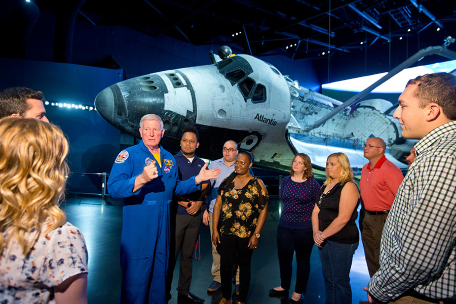 Guests touring Space Shuttle Atlantis with Astronaut Jon McBride during Fly With An Astronaut.