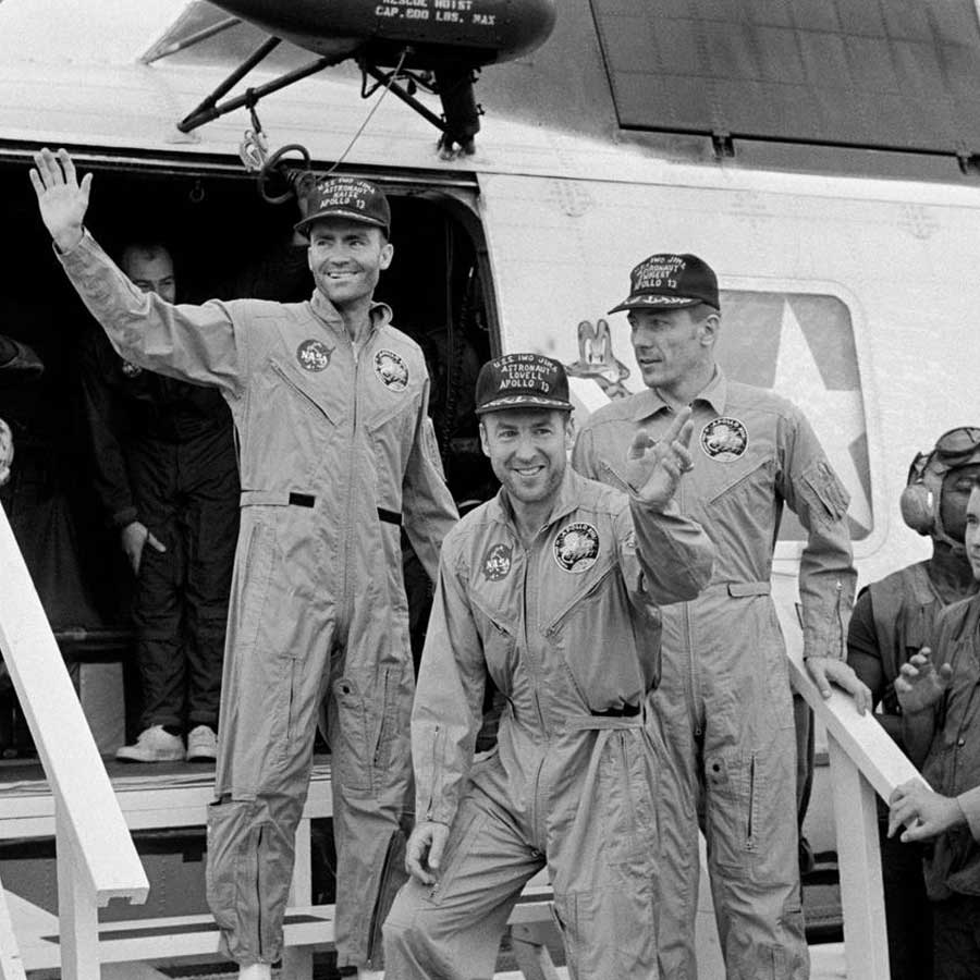 The crewmembers of the Apollo 13 mission, step aboard the USS Iwo Jima, prime recovery ship for the mission, following splashdown and recovery operations in the South Pacific Ocean. Exiting the helicopter which made the pick-up some four miles from the Iwo Jima are (from left) astronauts Fred W. Haise Jr., lunar module pilot; James A. Lovell Jr., commander; and John L. Swigert Jr., command module pilot.
