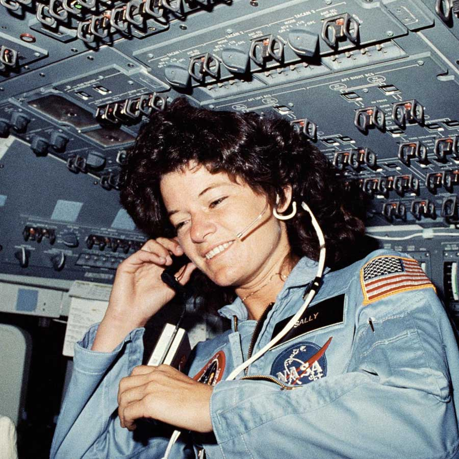 Astronaut Sally K. Ride, STS-7 mission specialist, communicates with ground controllers from the flight deck of the Earth-orbiting Space Shuttle Challenger.