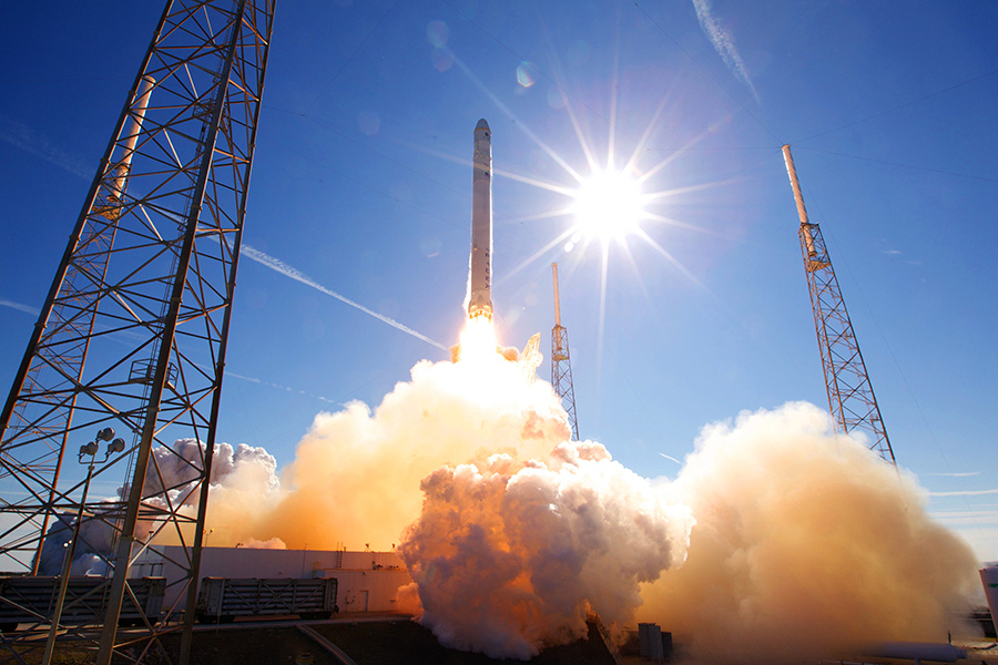 A SpaceX Falcon 9 launching from Kennedy Space Center.