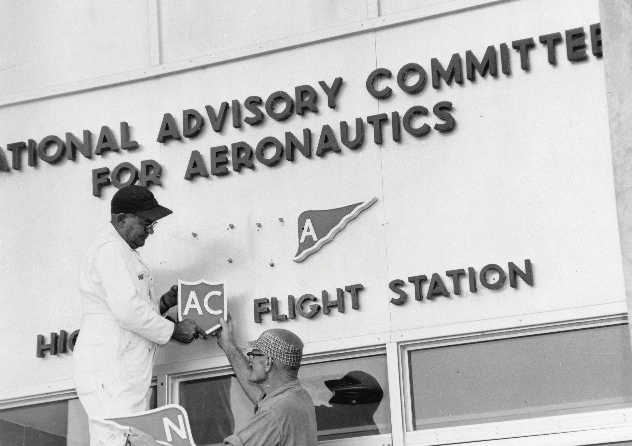 NACA sign being altered to NASA in 1958