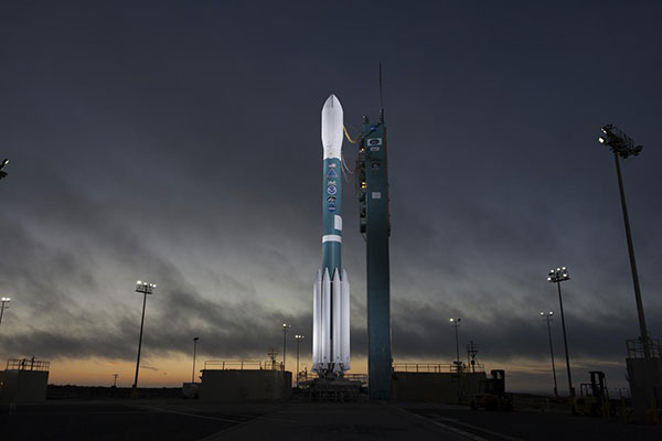 At Vandenberg Air Force Base in California, the gantry rolls back at Space Launch Complex 2 in preparation for the liftoff of the Joint Polar Satellite System-1, or JPSS-1, spacecraft.