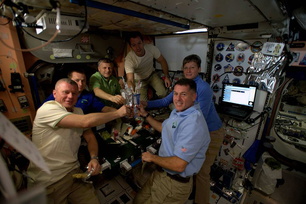 The crew members of Expedition 50 celebrated Thanksgiving in 2016 with rehydrated turkey, stuffing, potatoes and vegetables aboard the International Space Station.