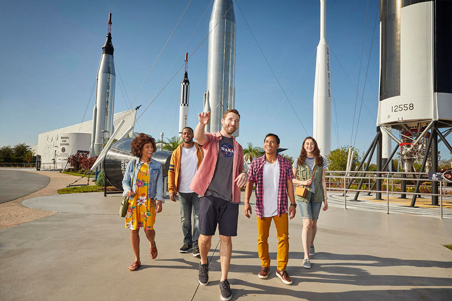 A group walks through and admires the Rocket Garden at Kennedy Space Center Visitor Complex.