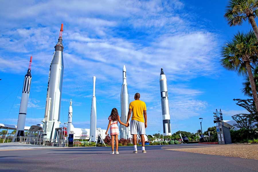 Father and daughter look in awe at the rocket garden at Kennedy Space Center VIsitor Complex.
