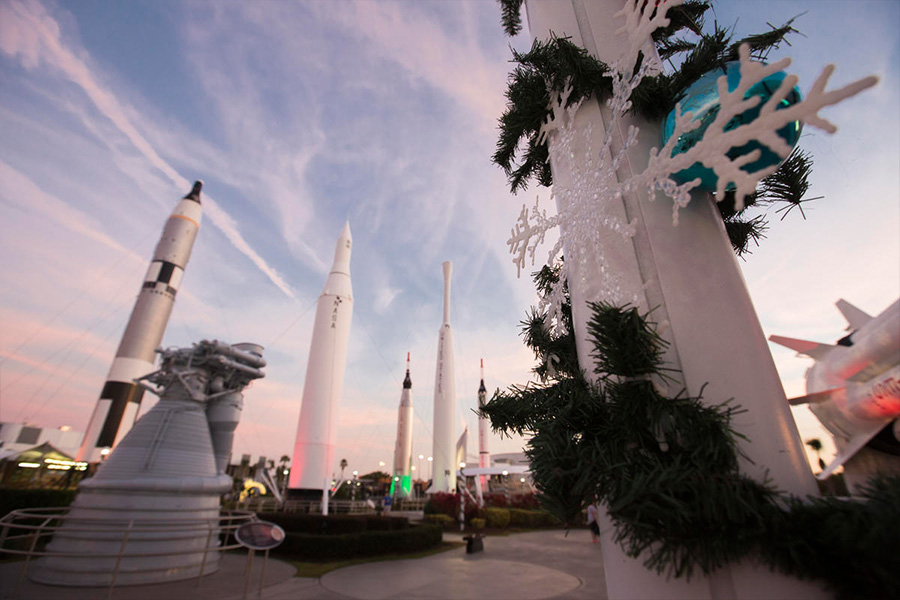 Holiday decor such as snowflakes grace the Rocket Garden at Kennedy Space Center Visitor Complex for Holidays in Space.