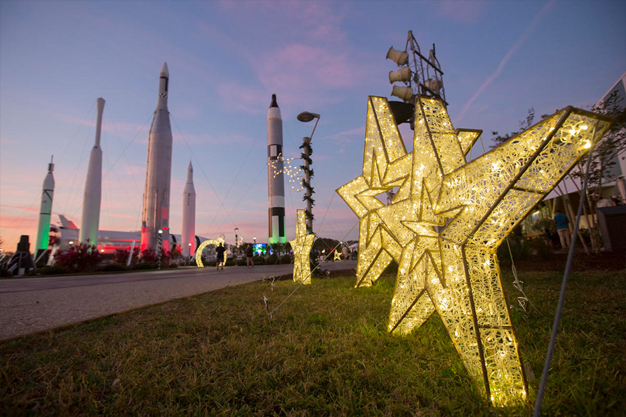 Festive star-shaped lights sit in the Rocket Garden at Kennedy Space Center Visitor Complex.