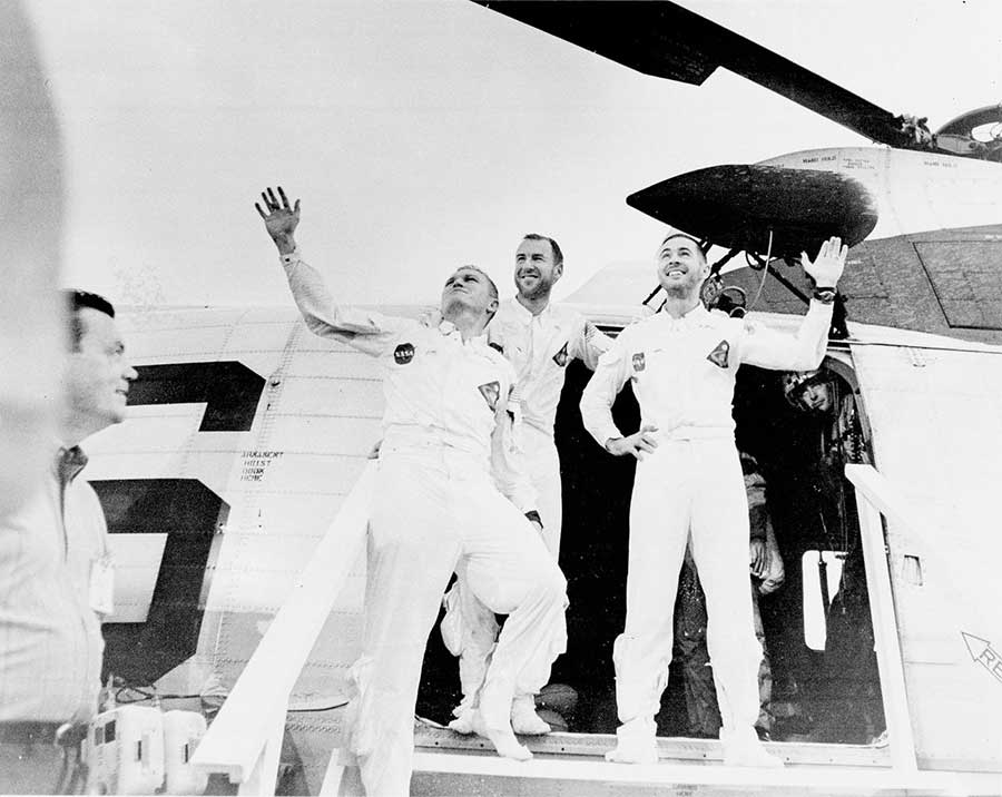 The crew of Apollo 8, the first manned lunar orbit mission, returned to Earth on December 27, 1968, and are pictured waving as they leave the recovery helicopter.