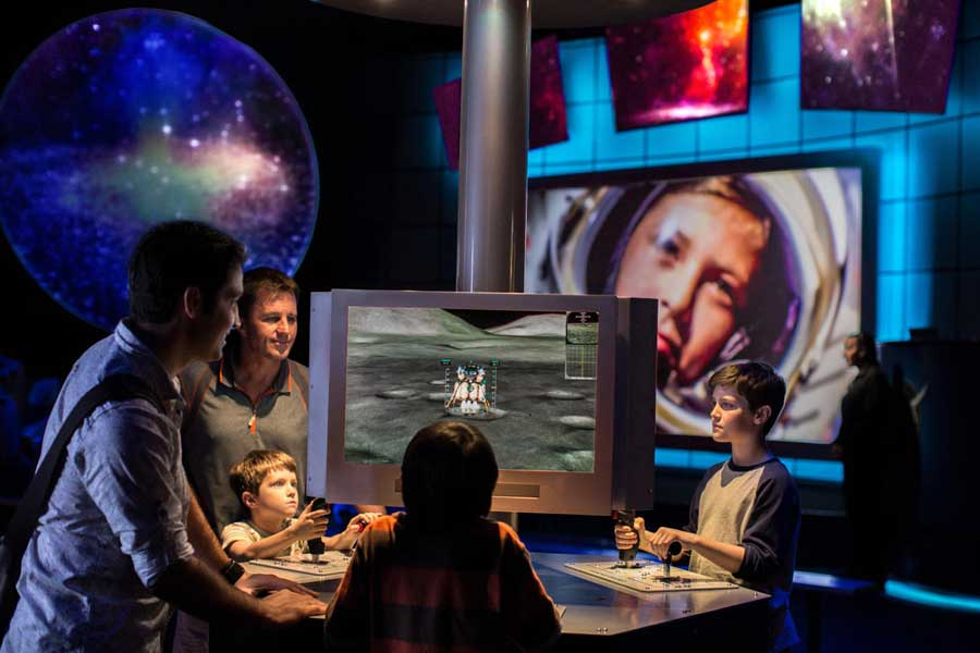 Family interacts with Mars simulator.