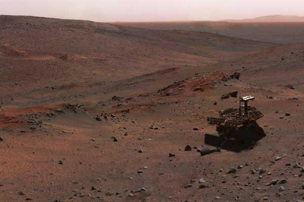 This synthetic image of NASA Spirit Mars Exploration Rover on the flank of Husband Hill was produced using Virtual Presence in Space technology.