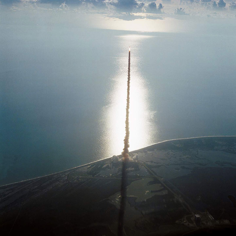 Space shuttle Discovery on August 30, 1984 launching through Kennedy Space Center airspace on its maiden voyage.