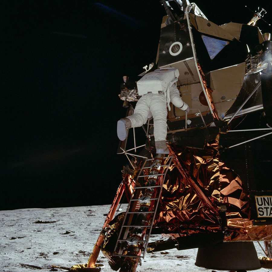 Astronaut Edwin E. Aldrin Jr., lunar module pilot for the Apollo program, egresses the Lunar Module (LM) 'Eagle' and begins to descend the steps of the LM ladder as he prepares to walk on the moon.