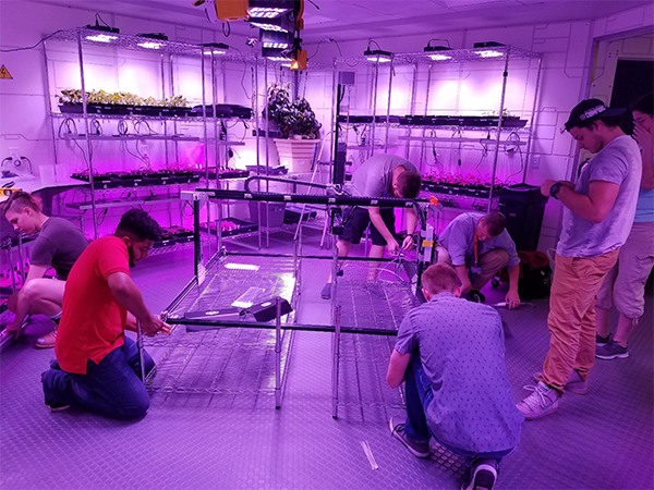 The Florida Institute of Technology project team assembling the FarmBot.