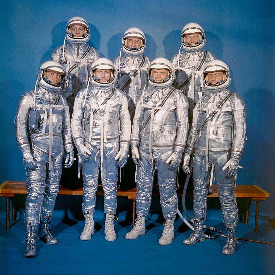 On April 9, 1959, NASA announced the Mercury 7 astronauts who would pioneer into the unknown and test whether or not humans could survive in space. Front row, left to right: Walter M. Schirra, Jr., Donald K. 'Deke' Slayton, John H. Glenn, Jr., and M. Scott Carpenter; back row, Alan B. Shepard, Jr., Virgil I. 'Gus' Grissom, and L. Gordon Cooper, Jr.