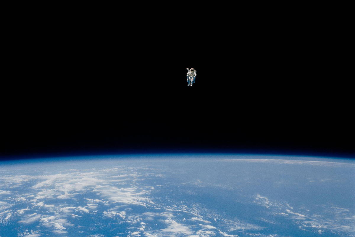 Astronaut Bruce McCandless performs the first untethered spacewalk.