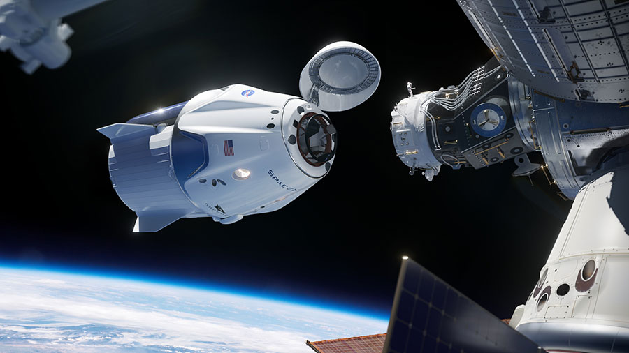 In this illustration, a SpaceX Crew Dragon spacecraft approaches the International Space Station for docking.