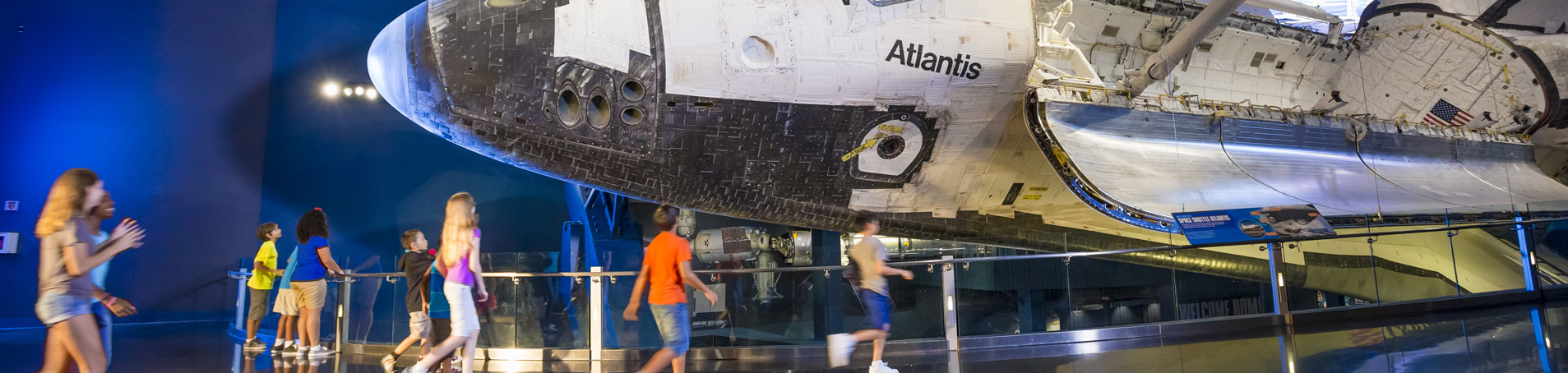 Children at Space Shuttle Atlantis exhibit